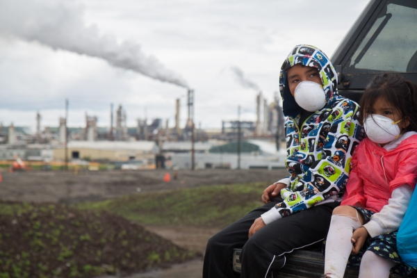 Children wear masks to protect themselves from the toxic fumes that surround their community during the fourth annual Healing Walk, 2013. Photo Credit: Ben Powless