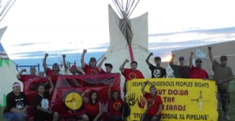 Moccasins of the Ground Frontline Activist Training on the Pine Ridge Homeland in collective action with Great Plains Tarsands Resistance and Tarsands Blockade, 2013. Photo Credit: People's Media Project and Owe Aku International