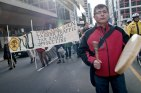 Hereditary Chief Toghestiy of the Likhts'amisyu Clan and Wet'suwet'en Nation, at the Royal Bank of Canada shareholders' meeting to confront them on their tar sands investments, 2010. Toghestiy is a supporter and organizer for the Unist'ot'en Camp. Photo Credit: Allan Lissner