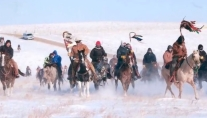 Spiritual horse rides to protect mother Earth and the communities of the plains and Great Lakes along the proposed KXL and Sandpiper/Alberta Clipper pipeline routes, respectively, took place in 2013. These rides are a continuation of a tradition of spiritual rides that are designated to pray for healing for the people and the land. The Big Foot Memorial Ride (pictured here) and the Keystone XL Pipeline ride were lead by Percy White Plume and coincided with community meetings and non violent direct acton trainings in stops along the route. Rides were organized by Honor the Earth, The Horse Spirit Society, and Owe Aku International and Moccasins on the Ground organizers. Photo Credit: Honor The Earth